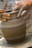 Close-up of potter turning a pot on a potter's wheel