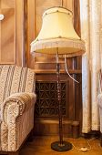 Retro Chair And Floor Lamp Torchere. A Torchere, Or Torch Lamp, Is A Lamp With A Tall Stand Of Wood  poster