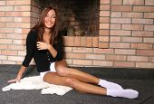 Brunette At A Fireplace poster