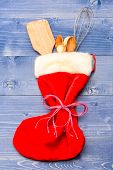 Great Christmas Gift Idea Stuffed Red Sock. Kitchenware As Wooden Spoons And Whisk Lay In Christmas  poster
