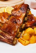 Delicious barbecued honey glazed ribs with baked potato