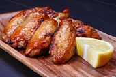 image of chicken wings  - Grilled chicken wings served on wooden board - JPG