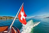 Switzerland Flag On Boat Flowing Luzern Lake, Scenic Landscape Of Switzerland poster