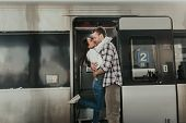 Satisfied Lady Kissing Outgoing Man Near Train poster