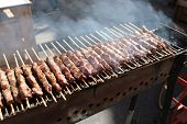 Grilled Lamb Skewers Sizzling On Barbecue, Among The Most Popular Street Food In The World. poster