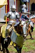 picture of jousting  - Mounted knight in a jousting show at a renaissance fair - JPG