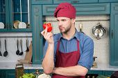 Culinary Recipe With Pepper. Chef Cooking Sweet Pepper. Vegetarian Cuisine Ingredient. Man Chef Wear poster