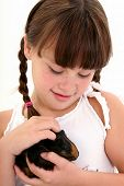 image of happy kids  - Eight year old girl holding her pet guinea pig - JPG
