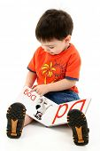 Adorable Toddler Boy Reading Alphabet Book.  Book pages created in photoshop.  Shot in studio over w