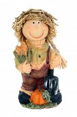 Country scarecrow with corn and pumpkin wearing straw hat.