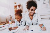 Child With Mother Draw With Pen. Studio For Draw. Exercise For Young Girl. Beautiful Girl And Mother poster