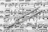 image of tuning fork  - Pitchfork on sheet music  - JPG
