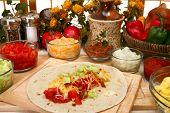 picture of chipotle  - Breakfast burrito in kitchen or restaurant - JPG