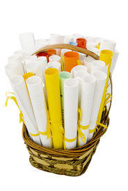 foto of gift basket  - wicker basket with paper rolls conceptual symbol of wishes - JPG