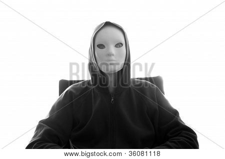 Hooded Figure With White Mask