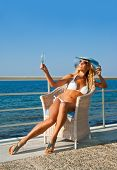 Sexy Woman Relaxing On Mediterranean Coast In Sunny Day