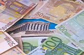 image of akropolis  - euro crisis in Greek with euro bank notes and the Akropolis building - JPG