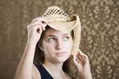 Confident Young Girl In A Cowboy Hat