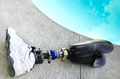 stock photo of prosthetics  - A prosthetic leg left beside the swimming pool - JPG