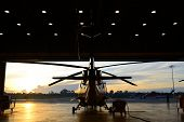 Silhouette Of Helicopter In The Hangar