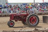 A Red Mccormick Deering Farmall Tractor