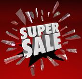 The words Super Sale breaking through red glass to illustrate a big clearance or closeout event at a