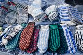 pic of stocking-foot  - lot of warm woven knit wool woollen sox socks stockings sell in outdoor street market fair.