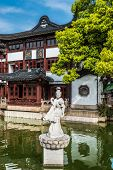 ancient statue on a pond in Fang Bang Zhong Lu old city shanghai china