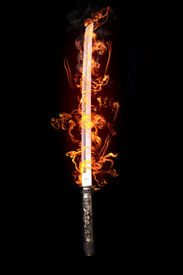 stock photo of longsword  - Japanese sword in flames on a black background - JPG
