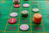 stock photo of roulette table  - roulette game with game table and green poker chips - JPG