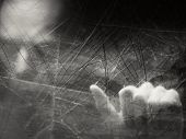 image of scratching head  - Spooky blurry human face behind dusty scratched glass - JPG