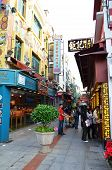 Visitors visit the famous souvenir street in Macau.