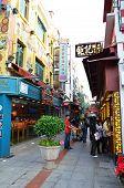 Visitors visit the famous souvenir street in Macau.