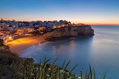 Carvoeiro Village While Climbing Of The Sun, Sunrise. Portugal.