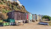 Old Fishing Huts On The Beach In The Village Of Ferragudo.