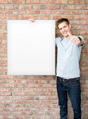 Young Man Holding Blank Whiteboard On Business Presentation