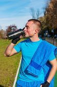 Jogger Drinking Water After Workout