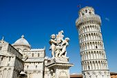 ITALY - MARCH 4: The Pisa Cathedral, The Fountain with Angels, and the Leaning Tower of Pisa in Piaz