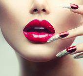 Makeup and Manicure. Red Long Nails and Red Glossy Lips. Sensual Mouth. Nail Art. Beautiful Sexy Lip
