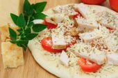 Un-cooked Chicken And Asiago Cheese Pizza