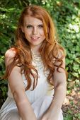 Beautiful Smiling Young Redhead Woman Portrait Outdoor