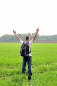 picture of knapsack  - happy teenager with knapsack in the summer field - JPG
