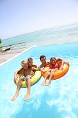 image of infinity pool  - Parents having fun with kids in swimming - JPG