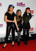 BOSTON-DEC 14: Singers Dinah Jane Hansen (L), Ally Brooke and Camila Cabello of Fifth Harmony attend KISS 108's Jingle Ball 2013 at TD Garden on December 14, 2013 in Boston.