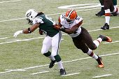 NEW YORK-DEC 22: Cleveland Browns outside linebacker Barkevious Mingo (51) attempts to tackle New Yo