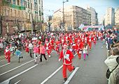 BELGRADE, SERBIA - DECEMBER 29, 2013: Unidentified participants of the sixth annual Belgrade Santa's Race on Dec. 29, 2013 in Belgrade, Serbia