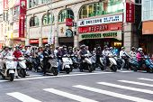 Scooter Riders During Morning Commute In Taipei, Taiwan