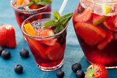 picture of sangria  - Refreshing sangria (punch) with fruits and berries