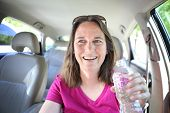 Woman drinking water while driving
