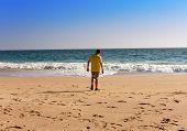 India. Kerala. The teenager on a beach